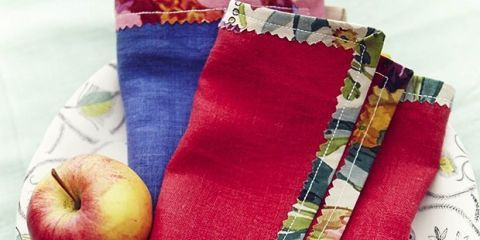 Red and blue folded napkins with apple