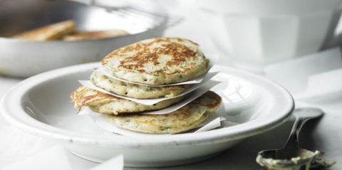 stack of buckwheat pancakes on white plate