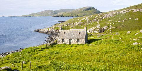 Derelict croft cottage in coastal location on Vatersay Island, Barra, Outer, Hebrides, Scotland