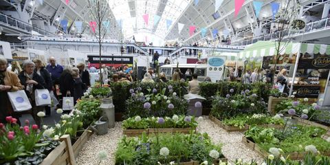 CL Spring Fair overview with planted beds and bunting above