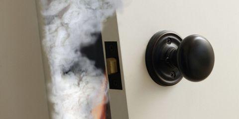 Black, Door, Paint, Material property, Dead bolt, Door handle, Household hardware, Still life photography, Handle, Hardware accessory,