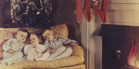 Christmas decoration, Holiday, Comfort, Interior design, Christmas eve, Living room, Christmas lights, Christmas ornament, Couch, Ornament,