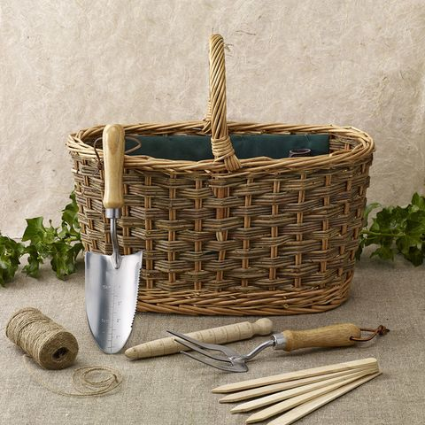"""<p>Keeping your hand-tools somewhere tidy whilst in the garden stops you from finding them, months later, rusting away in the compost heap. I know, I speak from experience on this! This natural buff willow trug and tool set includes a hand fork, hand trowel, garden markers, dibber and string. The tools will make easy work of your garden tasks and the attractive basket will help you tidy them away when the sun goes down. </p><p><strong data-redactor-tag=""""strong"""">Willow Garden Trug and Tool Set, Eaton Hampers & Basketware, £69.50</strong><span class=""""redactor-invisible-space"""" data-verified=""""redactor"""" data-redactor-tag=""""span"""" data-redactor-class=""""redactor-invisible-space""""><strong data-redactor-tag=""""strong"""">. </strong><a rel=""""noskim"""" href=""""http://www.notonthehighstreet.com/eatonhampersandbasketware/product/garden-trug-the-babe-in-the-woods?utm_source=Country_Living&utm_medium=partnership&utm_content=Web&utm_campaign=Giftlikeaneditor"""" target=""""_blank""""><strong data-redactor-tag=""""strong"""">Order here.</strong></a></span><br></p>"""
