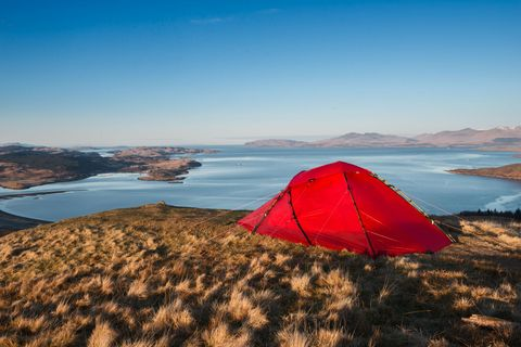 Red tent camping in countryside