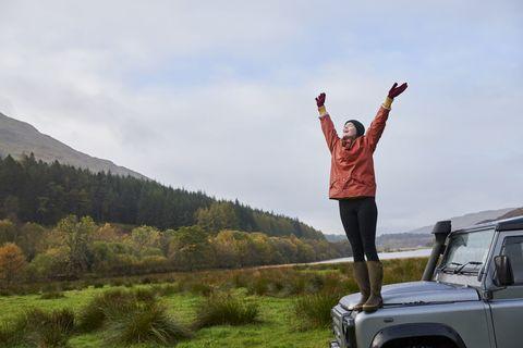 happy joy car countryside woman