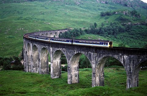 Bridge, Transport, Landscape, Aqueduct, Arch bridge, Viaduct, Rolling stock, Railway, Arch, Slope,