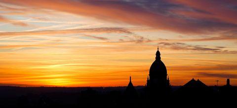 Leeds silhouette against sunset sky