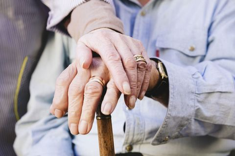 Elderly couple holding hands - close up