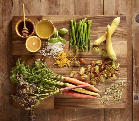 Chopping board with vegetables on