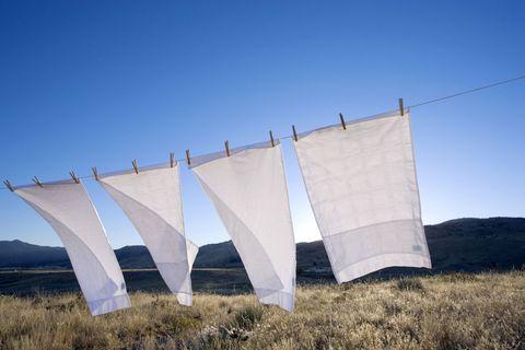 White pillowcases drying on washing line