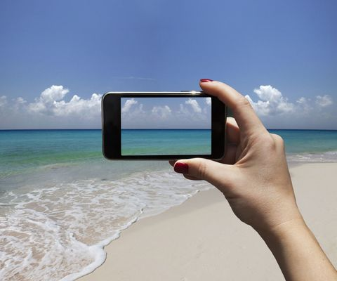 Holiday photo through smartphone of beach and sea