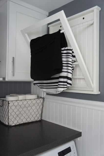 """<p>If a standalone version is out of the question (this blogger's laundry room is in her bathroom), line the walls with racks instead. Hinges help them tuck neatly out of the way when you're done.</p><p><em data-redactor-tag=""""em""""><a href=""""http://www.homewithbaxter.com/2013/05/house-tour-week-5-half-bathlaundry-room.html"""">See more at Home With Baxter »</a></em><em data-redactor-tag=""""em""""><a href=""""http://www.homewithbaxter.com/2013/05/house-tour-week-5-half-bathlaundry-room.html""""></a></em></p><p><strong data-redactor-tag=""""strong"""" data-verified=""""redactor"""">Shop a similar look:</strong> drying rack ($82, <a href=""""https://www.amazon.com/Laundry-Saving-Clothes-Clothing-Classic/dp/B07257KVWF/"""" target=""""_blank"""" data-tracking-id=""""recirc-text-link"""">amazon.com</a>)</p>"""