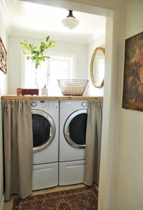 """<p>A butcher-block slab morphs the top of your machines into usable workspace. Plus, pull the cute curtains, and your utility room is suddenly just cozy nook. It's a clever trick for holiday party season — washing machines aren't exactly festive.</p><p><em data-redactor-tag=""""em""""><a href=""""http://theinspiredroom.net/room-tours/laundry-room-decorating-in-a-small-space/"""" target=""""_blank"""">See more at Heather Bullard »<strong data-verified=""""redactor"""" data-redactor-tag=""""strong""""></strong></a></em><a href=""""http://theinspiredroom.net/room-tours/laundry-room-decorating-in-a-small-space/""""><em data-redactor-tag=""""em""""></em></a></p><p><strong data-verified=""""redactor"""" data-redactor-tag=""""strong"""">Shop a similar look:&nbsp;</strong><span class=""""redactor-invisible-space"""" data-verified=""""redactor"""" data-redactor-tag=""""span"""" data-redactor-class=""""redactor-invisible-space"""">butcher block countertop ($299, <a href=""""v"""" target=""""_blank"""" data-tracking-id=""""recirc-text-link"""">amazon.com</a>), curtains ($10, <a href=""""https://www.amazon.com/Ottomanson-Blackout-Grommet-Curtain-Panel/dp/B06XXL5T5T/"""" target=""""_blank"""" data-tracking-id=""""recirc-text-link"""">amazon.com</a>)</span><br></p>"""