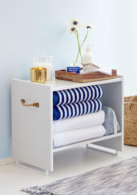 "<p>Design guru <a href=""http://www.housebeautiful.com/design-inspiration/a3587/gif-room-layering/"" target=""_blank"">Emily Henderson</a> upgraded IKEA's RAST nightstand in a snap, repurposing handles as mod table legs. Plenty of space in the linen closet? Top it with a mirror for a fresh side table, or contact paper for child's room. </p><p><em data-redactor-tag=""em"" data-tracking-id=""recirc-text-link""><a href=""http://www.redbookmag.com/home/decor/how-to/g2164/easy-diy-project-from-ikea/"" target=""_blank"">See more at Redbook »</a></em></p><p><br></p>"