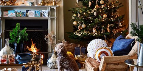 christmas living room rachel whiting blend traditional greenery with lustrous gold and silver decorations