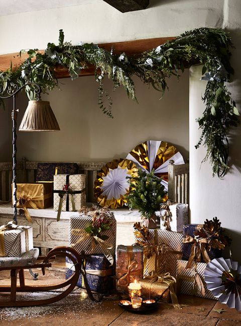 """<p>Delight visitors by creating a magical hallway with garlands of foliage, gilded paper decorations (<a href=""""https://www.amazon.co.uk/Paper-Snowflakes-Traditional-Christening-Decorations/dp/B00O9XWD22/ref=sr_1_4?ie=UTF8&qid=1511280041&sr=8-4&keywords=paper+christmas+decorations&dpID=61X8Y7nwBzL&preST=_SX300_QL70_&dpSrc=srch"""" target=""""_blank"""" data-tracking-id=""""recirc-text-link""""><em data-redactor-tag=""""em"""" data-verified=""""redactor"""">£17.99 for pack of 12, plain white, Amazon</em></a>) and beautifully wrapped presents.</p>"""