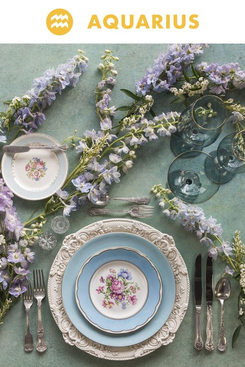 "<p>Aquarius is confident, original, and a little quirky. This spirit is interpreted with a freeform flat lay of hybrid delphinium euphorbia, joyfully making their own path along the tabletop.</p><p><em data-redactor-tag=""em""></em></p>"