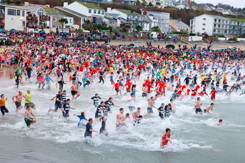 """<p>A comparatively new tradition, the annual swim in Saundersfoot sees hundreds of brave souls sprint across the sand to splash about in the icy Atlantic – all in the name of charity. Beginning in 1984, when 17 men entered the sea for a sponsored dip to raise money for their local sports club, what was meant to be a one-off has proven so popular it's now the main event in the village's social calendar. Each year, the swim has become bigger and bolder, with more than 1,000 participants coming from far and wide to take a bracing dunk and celebrate New Year.&nbsp;</p><p>More info here: <a href=""""http://www.saundersfootnyds.co.uk/"""" target=""""_blank"""" data-tracking-id=""""recirc-text-link"""">saundersfootnyds.co.uk </a><span class=""""redactor-invisible-space""""><a href=""""http://www.saundersfootnyds.co.uk/""""></a></span></p>"""