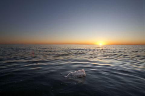 Plastic bottle floating on ocean