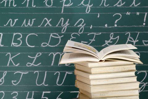 Letters on blackboard - books