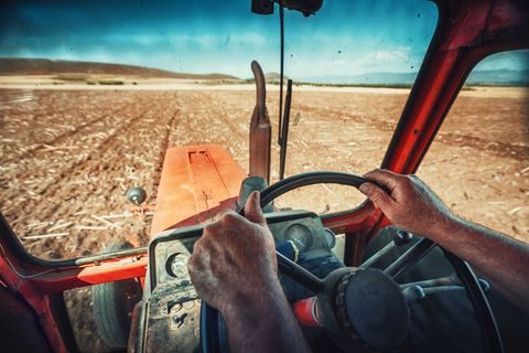 Farmer in tractor - close up