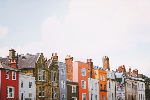 Window, Town, Residential area, Neighbourhood, Property, Facade, Roof, Building, Real estate, City,