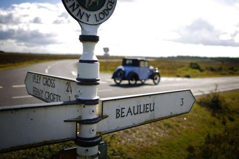 Motor vehicle, Sign, Plain, Signage, Street sign, Classic car, Antique car, Cumulus, Symbol, Gas,
