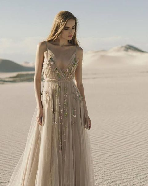 "<p>Etsy analysts have also noticed an uptake in interest for <a href=""https://www.etsy.com/listing/532301934/beige-wedding-dress-hand-embroidered?ref=shop_home_active_14"" target=""_blank"">embellished gowns</a> as brides depart from the more traditional dresses.</p>"