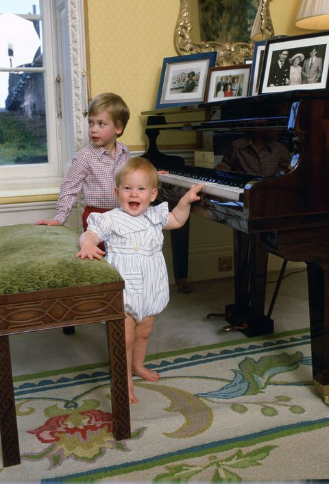 <p>Harry, 11 months, plays with the piano with his brother William, three, at their home in Kensington Palace.</p>