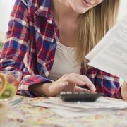 woman paying bills household expenses money save