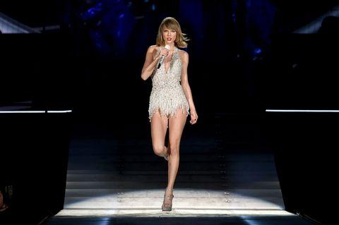 Human leg, High heels, Dress, Waist, Fashion show, Runway, Knee, One-piece garment, Fashion model, Thigh,