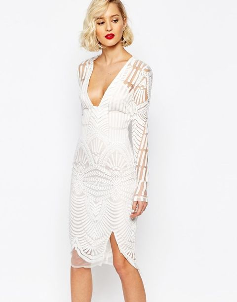 Sleeve, Shoulder, Human leg, Joint, White, Standing, Style, Elbow, Fashion model, One-piece garment,