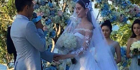 Clothing, Dress, Event, Bridal clothing, Bridal veil, Trousers, Petal, Veil, Photograph, Wedding dress,