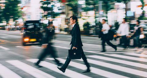 Road, Pedestrian crossing, Street, Trousers, Urban area, Infrastructure, Standing, Zebra crossing, Photograph, Outerwear,