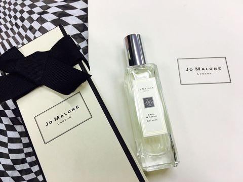 Fluid, Liquid, Bottle, Perfume, Cosmetics, Material property, Ribbon, Glass bottle, Brand, Label,