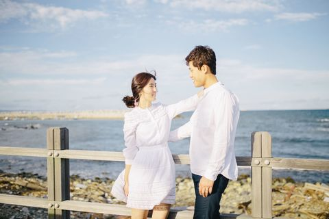 Sky, Shirt, Photograph, Coastal and oceanic landforms, Happy, People in nature, Summer, Interaction, Honeymoon, Love,
