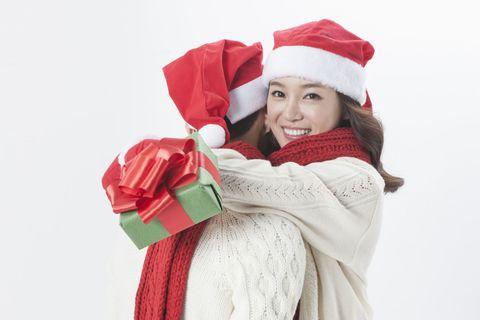 Textile, Red, Happy, Winter, Headgear, Costume accessory, Carmine, Costume, Holiday, Costume hat,
