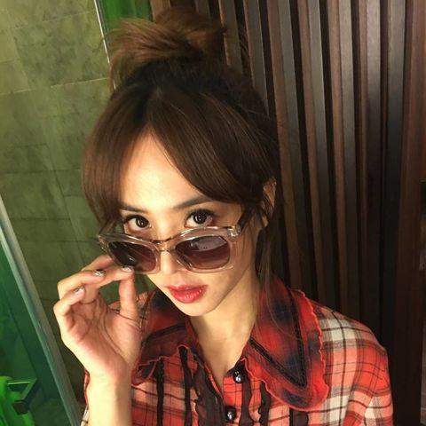 Eyewear, Vision care, Lip, Plaid, Tartan, Pattern, Eyelash, Brown hair, Earrings, Design,