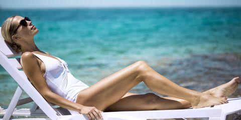 Sun tanning, Vacation, Leg, Sitting, Leisure, Beauty, Skin, Sunlounger, Summer, Human leg,