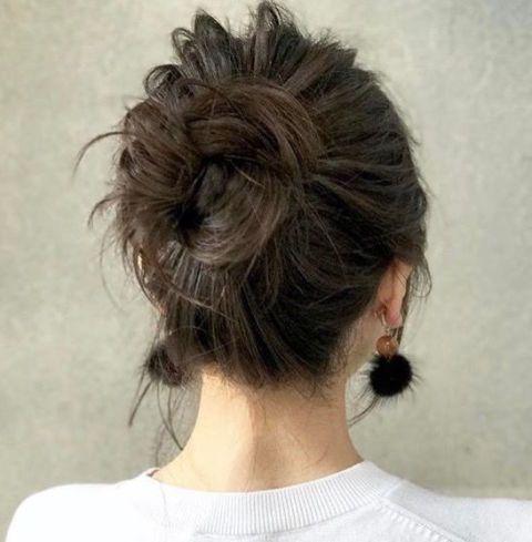 Hair, Hairstyle, Chin, Chignon, Brown hair, Long hair, Bun, Neck, Ear, Black hair,