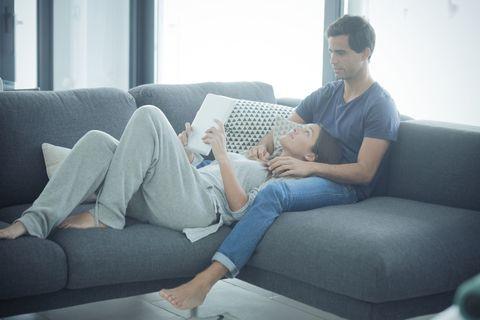 Couch, Furniture, Comfort, Room, Living room, Sitting, Leg, Footwear, Sofa bed, Interior design,