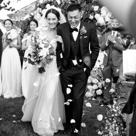 Clothing, Dress, Petal, Bridal clothing, Event, Trousers, Coat, Bouquet, Wedding dress, Photograph,