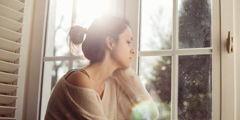 Hair, Shoulder, Window, Light, Hairstyle, Room, Sunlight, Interior design, Window covering, Bun,