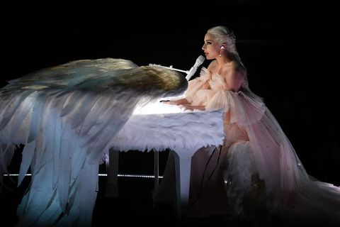 Angel, Performance, Performing arts, Event, Stage, Performance art, Wing, Supernatural creature, Fictional character, Dance,