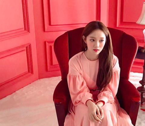 Pink, Clothing, Shoulder, Beauty, Skin, Sitting, Lip, Outerwear, Fashion, Long hair,