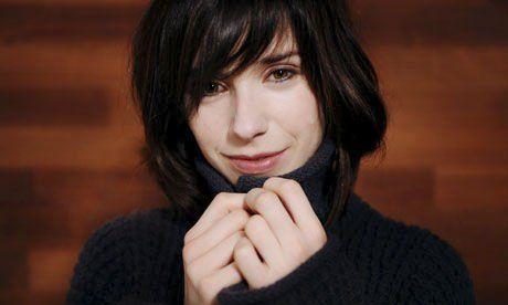 Hair, Face, Hairstyle, Chin, Black hair, Cheek, Lip, Nose, Layered hair, Gesture,