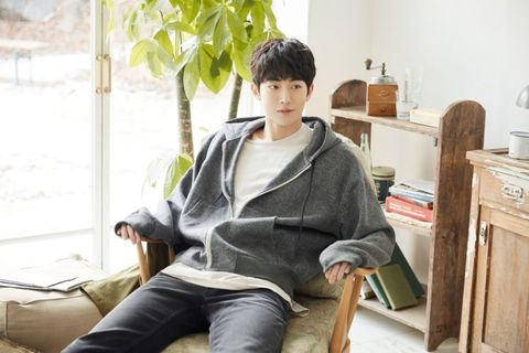 Sitting, Neck, Outerwear, Room, Furniture, Sleeve, Sweater,