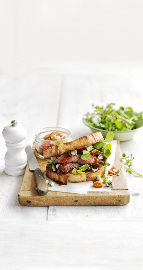 steak sandwich with blue cheese and sweet and sour tomatoes