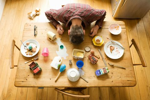 man face down at messy table