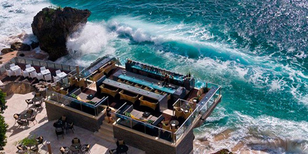 """Look out across the Indian Ocean from this stunning rock-top bar at the <a href=""""http://ayanaresort.com/en/home"""" target=""""_blank"""">Ayana Resort and Spa</a>. Situated just 14 metres above the water, listen as the waves crash onto the rocks below while you enjoy a few sundowners accompanied by the view of a lifetime."""